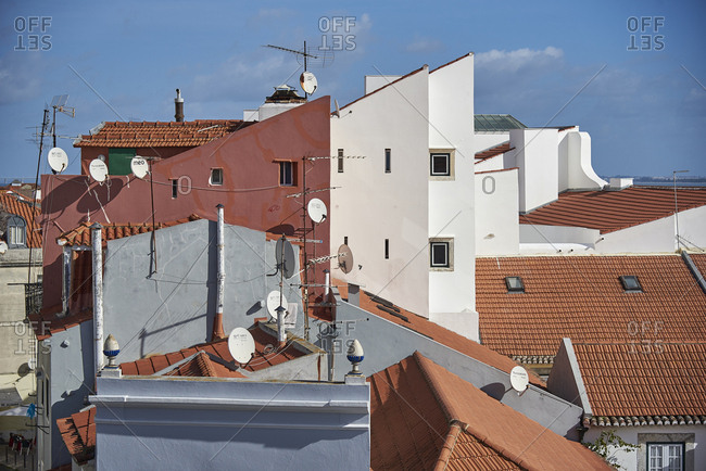 Lisbon, Portugal - 26 January, 2018: Looking over a jumble of rooftops and satellite dishes in the old quarter