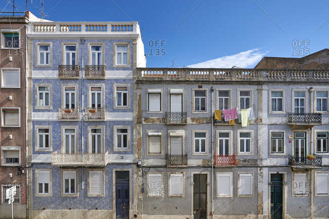 Lisbon, Portugal - 08 February, 2018: Facade of apartment blocks decorated with patterned tiles in old quarter