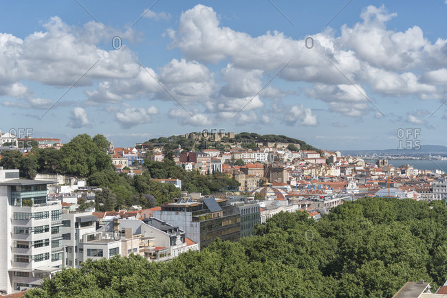 Lisbon, Portugal - 06 May, 2017: Looking over rooftops towards Moorish hilltop Sao Jorge Castle