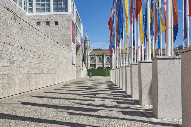 Lisbon, Portugal - 11 June, 2017: Looking along the facade of Berardo Collection Museum to the Jeronimos Monastery