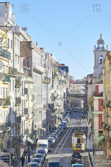 Lisbon, Portugal - 04 December, 2017: High angle view down a busy street with tram and cars sharing road