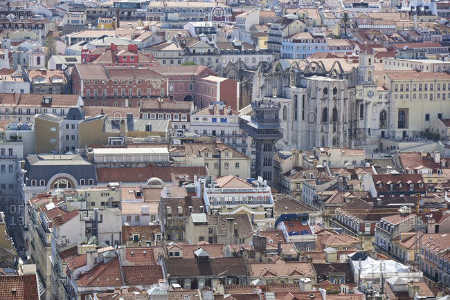 Lisbon, Portugal - 25 April, 2016: Densely packed cityscape including sights of Carmo Convent and Santa Justa Lift