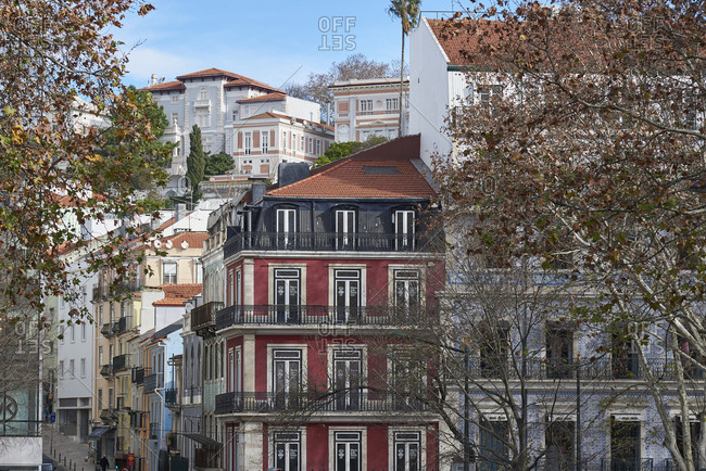 Lisbon, Portugal - 06 January, 2018: Colorful apartment buildings and mansions rise up hill in upmarket neighborhood