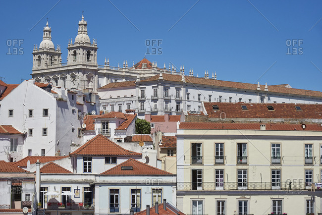 Lisbon, Portugal - 03 May, 2016: Renaissance spires of Church of Sao Vicente of Fora rising over roofs of apartment buildings