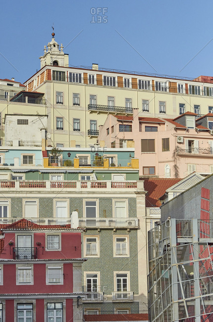 Lisbon, Portugal - 31 January, 2018: Looking up at colorful apartment buildings lit by low winter sun