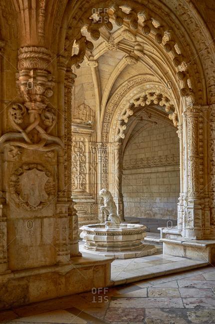 Fountain seen through arch of the Jeronimos Monastery, Lisbon, Portugal