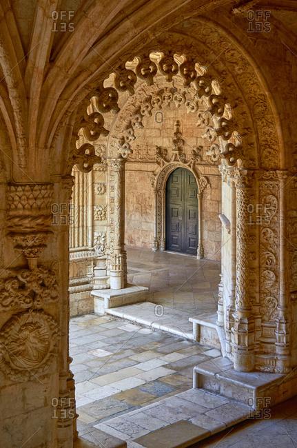 Entrance seen through arch of the Jeronimos Monastery, Lisbon, Portugal