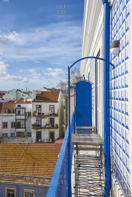 Bistro set on a blue balcony in Lisbon, Portugal