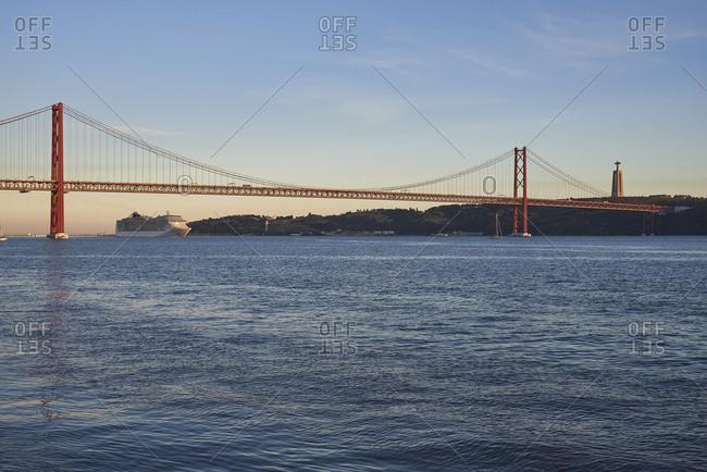 Cruise ship in Tagus river and the 25 de Abril Bridge, Lisbon, Portugal