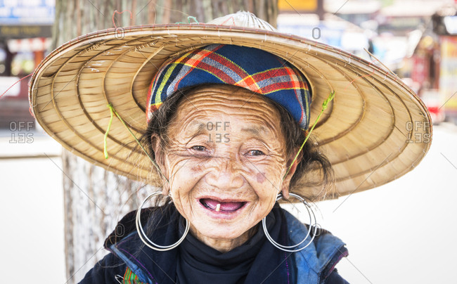 May 14, 2015: A characterful portrait of a Sapa tribeswoman with one tooth looking at the camera. Sapa, Northern Vietnam