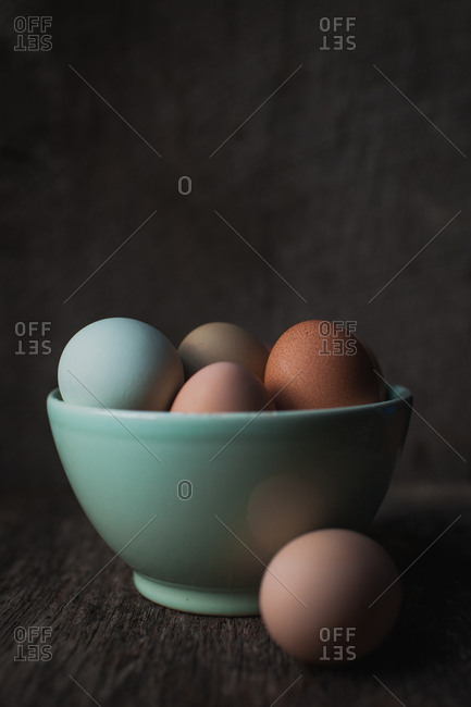 Bowl full of multicolored eggs