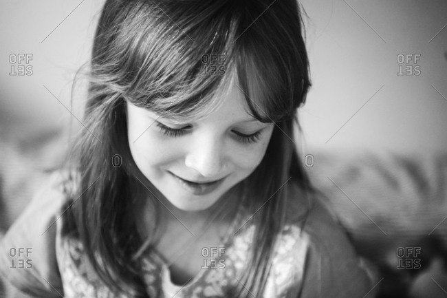 Portrait of a smiling little girl in black and white