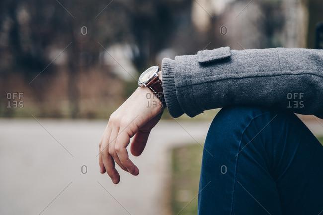 Young man wearing stylish brown watch