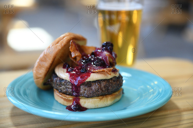 Hamburger topped with bacon and berry compote