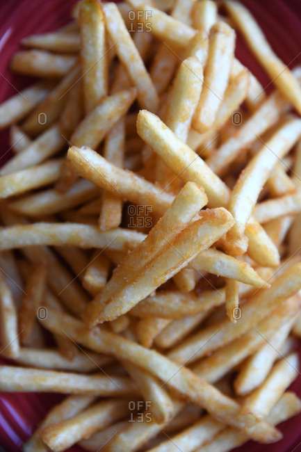 Plate full of freshly made French fries