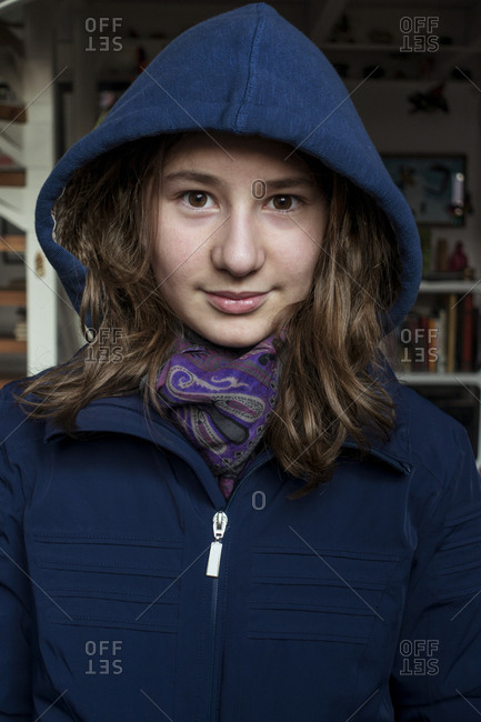 Portrait of an adolescent girl with brown eyes wearing a hooded sweatshirt