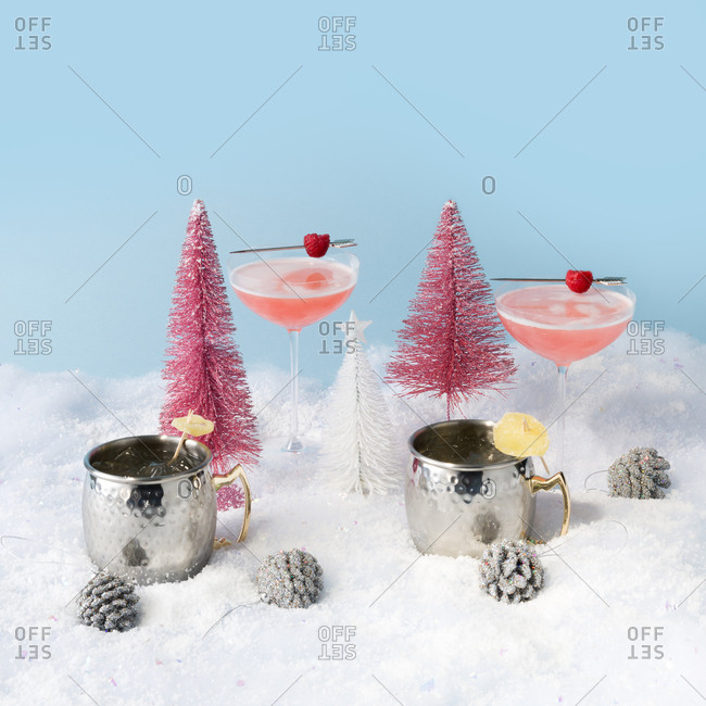 Colorful still life with holiday cocktails and ornaments