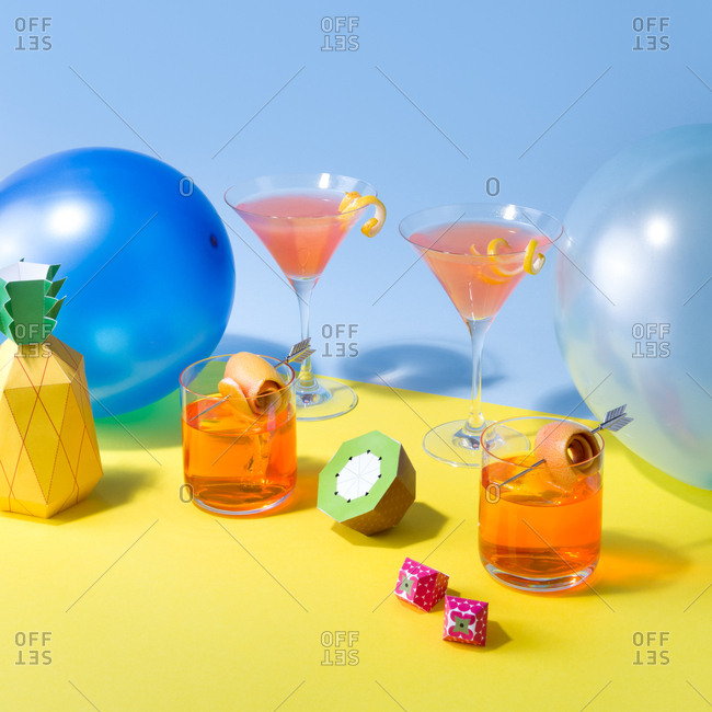 Colorful still life of citrus cocktails and balloons