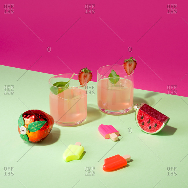 Colorful still life with summer cocktails and ornaments