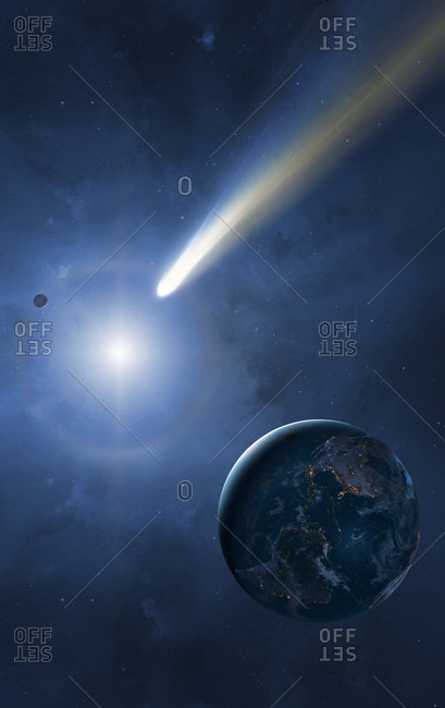 Illustration of the Earth, Moon and Sun showing a passing comet. Cities are seen glistening, defining the edges of the Earth's continents. Comets are balls of loosely packed 'dirty ice'. As they near the Sun, their gases sublimate and form long tails blustering away from the star. The tails can stretch for tens of thousands of kilometres, dwarfing even the Earth-Moon separation.