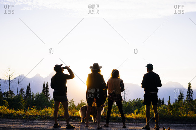 Group of friends enjoying the sunset