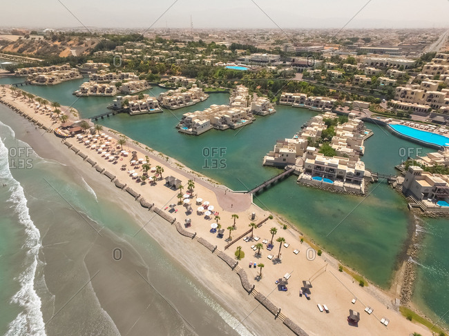 AL DHAIT SOUTH, UNITED ARAB EMIRATES - 16 April 2016 : Aerial view of luxury houses and beach on the coast of Al Dhait south.