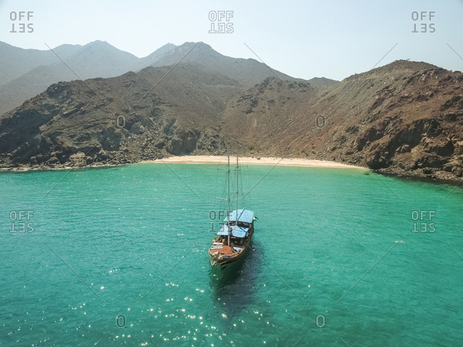 Aerial view of a sailboat in the picturesque bay of Khor Fakkan, United Arab Emirates.