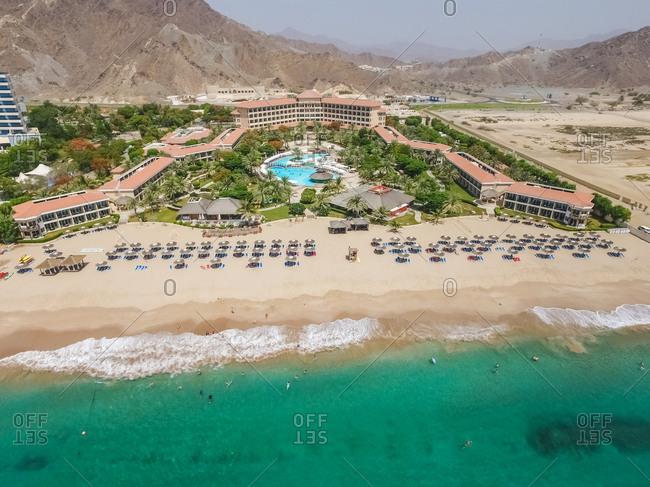 AL AQAH, UNITED ARAB EMIRATES - 17 June 2016 : Aerial view of a resort on Al Aqah beach, United Arab Emirates.