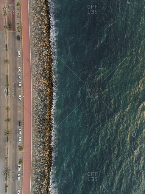 Aerial view of a rocky beach and roads on The Palm Jemeirah in Dubai, United Arab Emirates.
