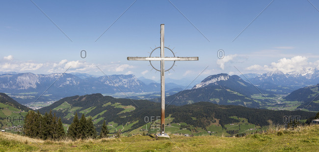 Large crucifix against mountain