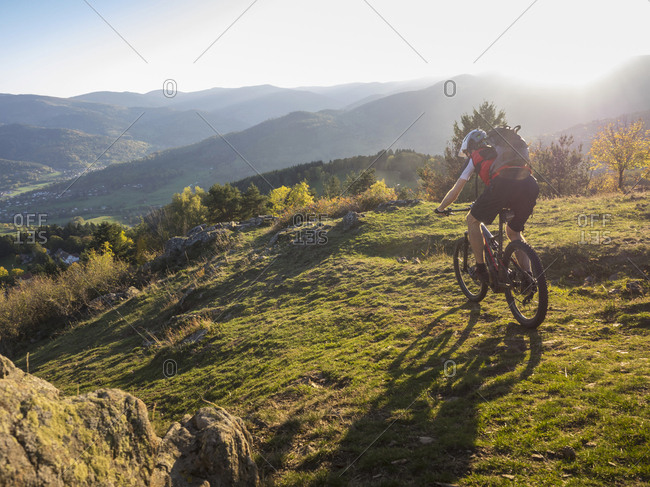 Mountain biker cycling on single trail near the commune of Munster, France