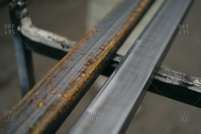 Close up comparison of rusty and non-rusty metal bars