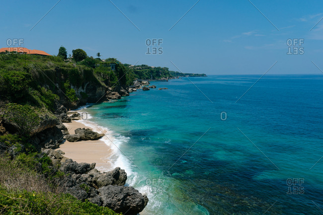 Beach and turquoise waters on the coast of Indonesia