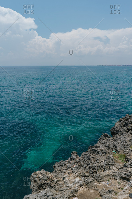 View of turquoise waters from rocky shores of Bali