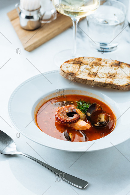 Seafood soup served with wine