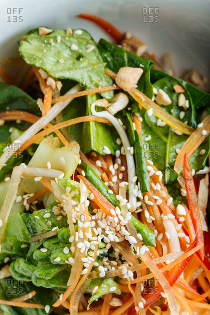 Close up of an Asian dish with vegetables and sesame seeds