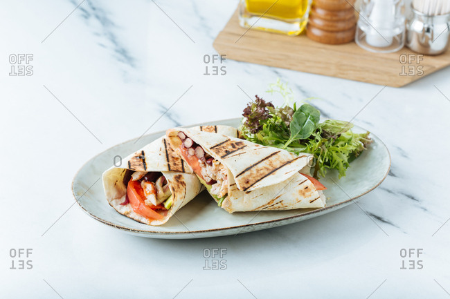 Grilled wrap served with salad