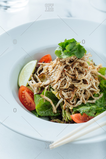 Salad topped with shredded meat