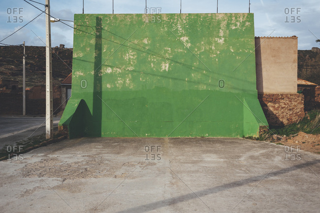 Isolated green fronton games wall in a rural village in Spain