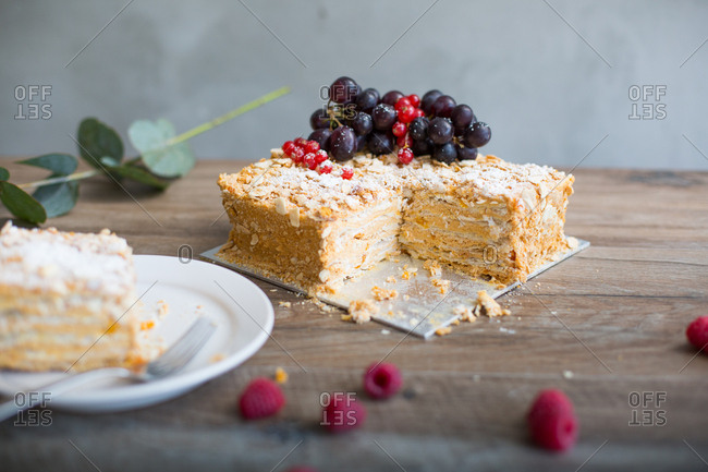 High angle view of Russian Napoleon Cake decorated with variety of berries
