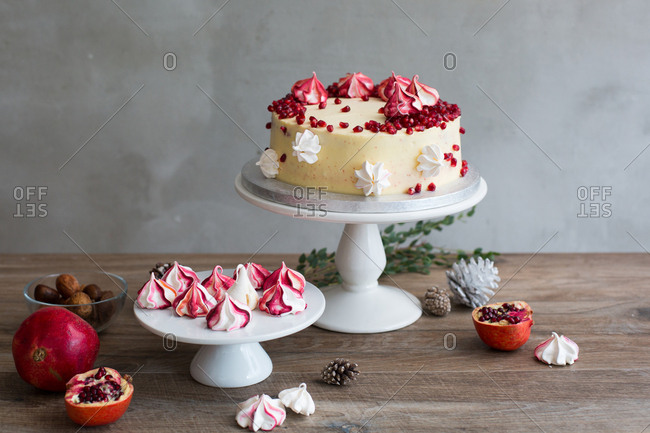 Traditional red velvet cake garnished with passion fruit presented on cake stand