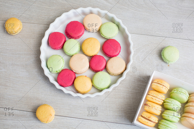 High angle view of colorful macaroons laid out in a pie dish