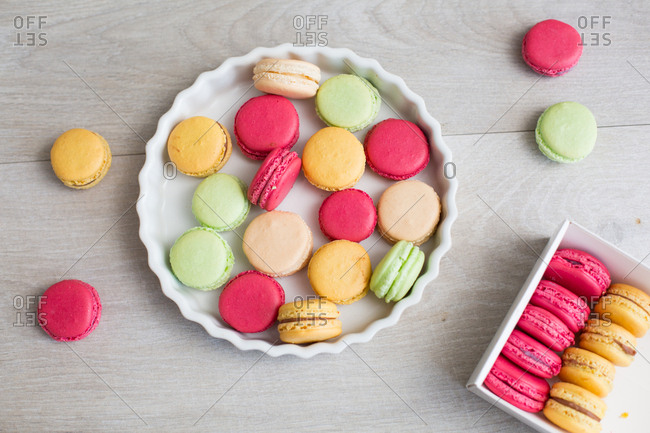 Top down view of random assortment of macaroons in pie dish