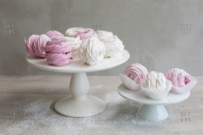 High angle view of soft fluffy zefir with a dusting of powder sugar on cake stand