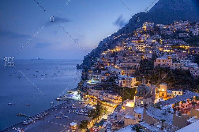 July 3, 2009: Positano and beach at dusk, Amalfi Coast (Costiera Amalfitana), UNESCO World Heritage Site, Campania, Italy, Mediterranean, Europe