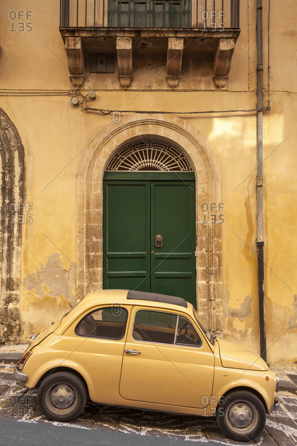 October 6, 2009: Old Fiat 500 parked in street, Noto, Sicily, Italy, Europe