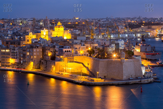 October 29, 2017: Night view of Senglea, one of the Three Cities, and the Grand Harbour in Valletta, European Capital of Culture 2018, Valletta, Malta, Mediterranean, Europe
