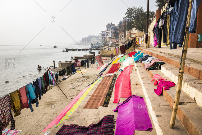 January 4, 2017: Washing drying on ghats next to the River Ganges, Varanasi, Uttar Pradesh, India, Asia