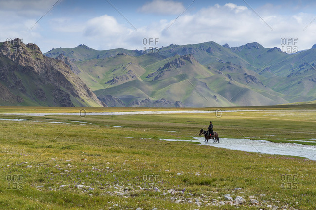 July 11, 2017: Horseman riding in Kurumduk valley, Naryn province, Kyrgyzstan, Central Asia, Asia