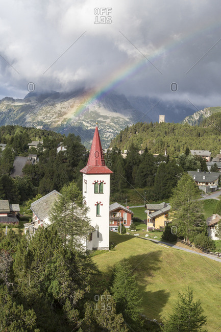 Rainbow over Chiesa Bianca, Maloja, Bregaglia Valley, Engadine, Canton of Graubunden (Grisons), Switzerland, Europe